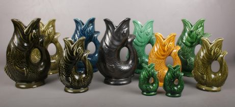 A group of Dartmouth Devon glazed gurgling fish jugs. Various colours and sizes.