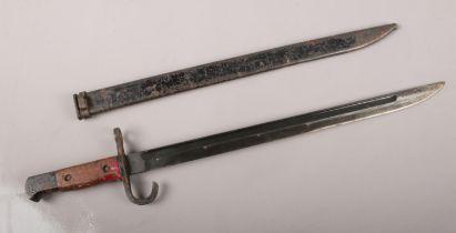 A WW2 Bayonet with scabbard. 52cm length.