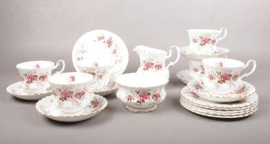 A Royal Albert 'Lavender Rose' tea set. tea cups, saucers, tea plates, Milk jug, sugar bowl.