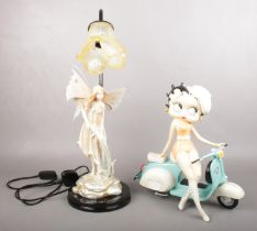A boxed limited edition of Betty Boo on a scooter, together with a fairy figured lamp. Betty Boo: