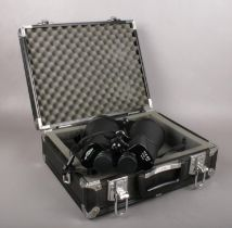 A large pair of Opticron 11x80 field binoculars. In hard carry case.