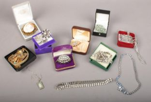 A group of costume jewellery. Brooches, Wedgwood necklaces, necklaces etc.