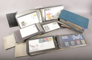 Four Albums of First Day covers & Guernsey stamp album . Mainly 1980's with some 1960's.