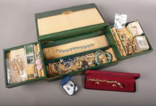 A jewellery box with contents of costume jewellery. Includes marcasite fox brooch, simulated pearls,