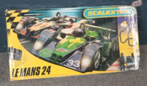 A boxed Scalextric Le Mans 24, including track and cars.