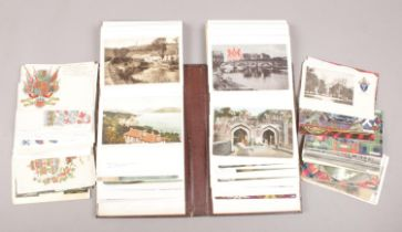 A collection of vintage postcards, loose and in album. Over 100.