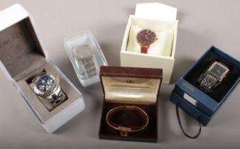Five ladies and gents wristwatches. Includes Sekonda, Adidas, Regency etc.