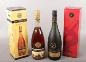 Two boxed full & sealed bottles of Remy Martin fine champagne cognac. Including Grand Cru example,