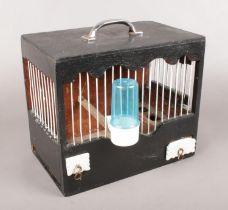 A small vintage wooden birds cage. (22.5cm x 25cm)