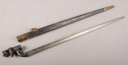 A WW2 socket Bayonet with scabbard. Marked 3920. 64cm length