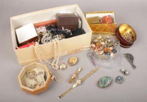 A group of costume jewellery. Beads, necklaces, brooches etc