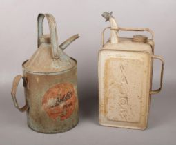 Two Vintage Paraffin Cans. Comprising of:- An Aladdin Pink Paraffin Can and a Valor Paraffin Can (