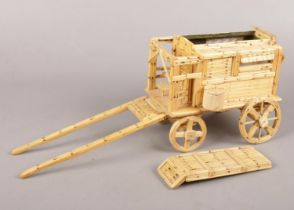 A scratch build gypsy caravan made from match sticks with fitted interior.