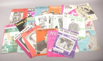 A collection of 1960s sheet music and magazines.