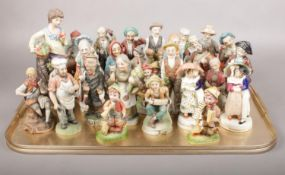 A tray of mostly ceramic figures. Including Capodimonte style examples, etc.