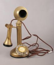 A stick brass telephone. Comprising of a ring dial to the circular base and etched to the front G