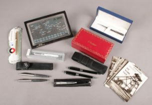 A group of collectables. Includes Parker, Sheaffer and Waterman pens, Cartier sunglasses case,