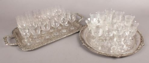 Two Silver Plate Trays along with a Large Collection of Early Twentieth Century Glasses. Condition