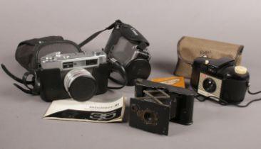 A group of Vintage camera's. Kodak Eastman Vest pocket ( U.S. patents 1902-1913), Yashica Minister