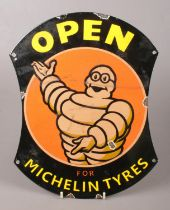 A reproduction enamelled metal advertising sign for Michelin Tyres.