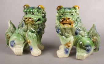 A pair of ceramic Chinese temple lions/ dogs of Fu. 32.5cm h.