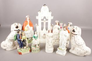 A collection of ceramics. To include two Staffordshire dogs, The Sailor Returns and a religious