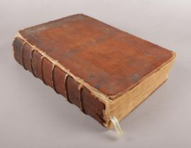 An 18th century leather bound bible. Dated to 1774 to inside cover.