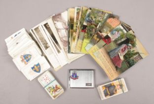 A group of collectables. Includes Bamforth postcards, stamp case, cigarette cards etc.