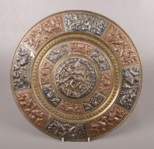 A bronze coloured Indian plaque. With foil overlay decoration. Presented by the Indian Society of