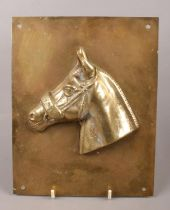 A brass horse racing plaque, Red Rum.