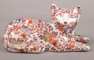 A 20th Century Chinese cat decorated in the Imari palette. Has character markings on the bottom.