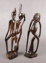 Two large carved hardwood African figures. Tallest 60cm.