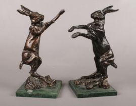 A pair of cast metal book ends depicting fighting hares. H:26cm.