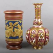 A Zsolnay reticulated vase along with a Victorian spill vase decorated with a battle scene.
