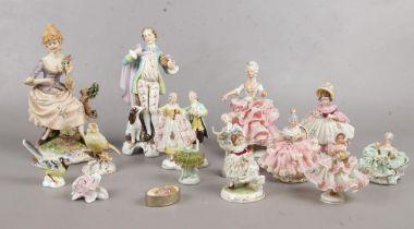 A group of assorted ceramic figurines. Dresden etc