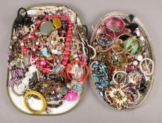 Two large trays of Costume Jewellery. Includes Necklaces, Bangles and Earrings etc.