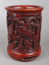 A Chinese boxwood brush pot. With carved landscape and figure decoration. Height 15.5cm.