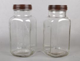Two vintage glass 'Holland Toffee' jars with Bakelite screw lids. Has 'Best on Earth' pressed into