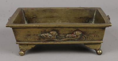 A Small Oriental Brass Tray Raised on Supports. Decorated with a River Scene on the Side of the