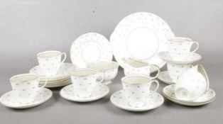 A Susie Cooper part tea set. cups/saucers, milk jug, sugar bowl, side plates etc crack in sugar