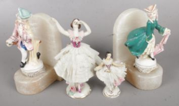 A Pair of Alabaster Bookends, with Two Dresden Figures. Condition Fair, Slight damage to the Dresden