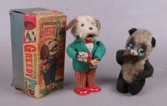 Two mechanical clock work toys. Including boxed The Greedy Pup example, etc.
