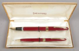A Sheaffer Statesman Fountain Pen and Mechanical Pencil Set (Fountain Pen with Snorkel Filler and