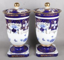 A Large Pair of Roselle Occ & Co Staffordshire Lidded Urns. Height 52cm. Overall good condition.