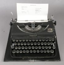 A Cased Imperial Model T Typewriter. Typewriter is coloured in matt black with Royal Crest to the
