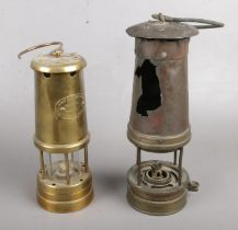 Two miners lamps. Including Lamp & Limelight Company, Hockley example, etc. Largest example has a