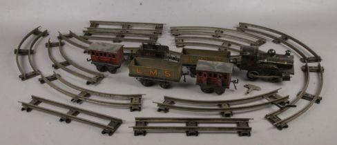 A quantity of clockwork railway. Including Locomotive, carriages, track, etc.