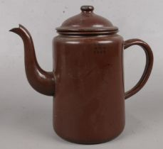 A WWII metal military teapot, baring the broad arrow mark.