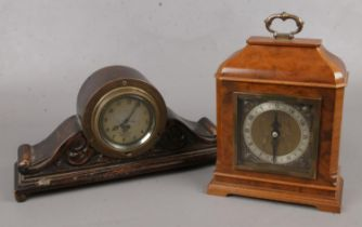 Two vintage clocks. Includes Smiths car dashboard example mounted in carved oak case and a burr