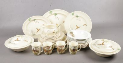 A Royal Doulton 'The Coppice' pattern part dinner service (29 pieces) together with ten pieces of